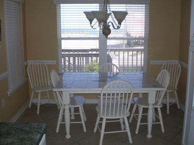 Eating area with view of beach and gulf