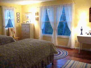 Popham Beach house photo - Lake view twin bedroom has dresser, drop-leaf table, and large closet.