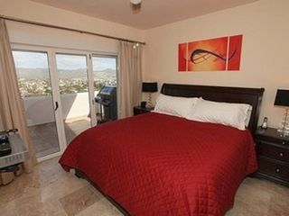 Cabo San Lucas condo photo - Luxurious King Bed w/ Ensuite & Walk-In Closet. 47 Inch LCD TV w/ Blu-Ray Player