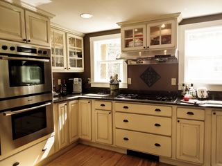 Fryeburg cottage photo - Gourmet kitchen with five-burner gas stove and convection ovens.
