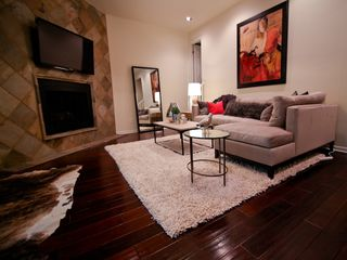 Austin townhome photo - Relax by the fireplace while you enjoy movies and events on the 52 inch plasma.