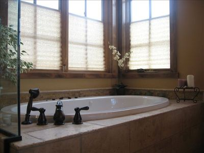 Master Bath Jetted tub with travertine marble
