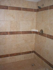 2nd Bathroom features new walkin tile shower with matching tile flooring