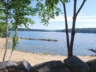 Laconia house photo - One of 2 gently sloping, private beaches