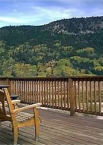 Huge wrap-around deck has views of Continental Divide and State Wildlife Refuge.