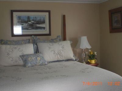 The first master bedroom is comfortable and spacious and has a queen sized bed.