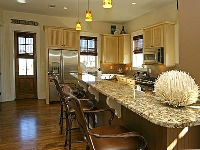 Kitchen w/9' Granite Bar & Swivel Barstools