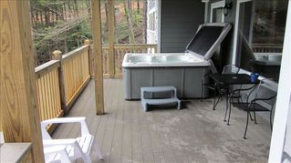 La Follette cabin photo - Lower level deck with hot tub overlooking the lake