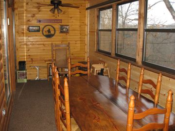 Huge enclosed deck with seating for 6.