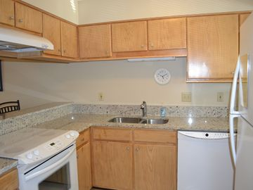 Fully Stocked Kitchen with Granite Countertops
