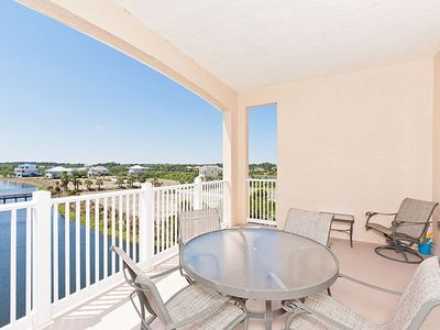 Enjoy sunset views of Ocean Hammock lakes & resort - The private balcony offers the best view of beautiful Florida sunsets. Bring your morning cup of coffee or your evening glass of wine to the balcony. You'll find yourself wanting to stay out here all day.