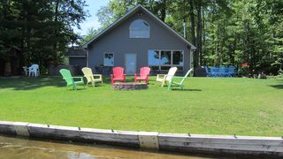 Interlochen cottage photo - Sit by the fire with an amazing view of the lake