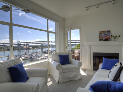 Every room in this top floor unit has an unobstructed view of the river.