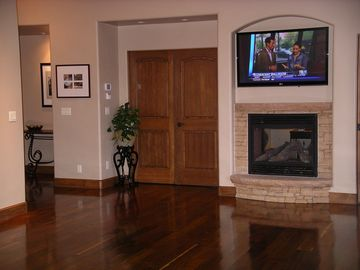 livingroom fireplace and double doors to master bedroom