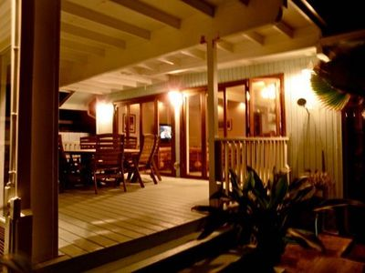 The porch at night is perfect for playing cards and listening to the ocean