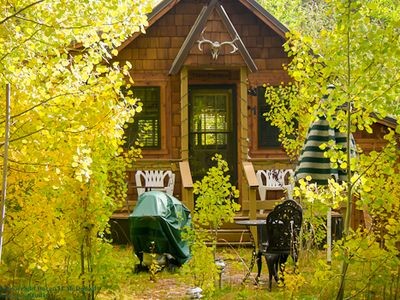 A colorful cabin in the fall.