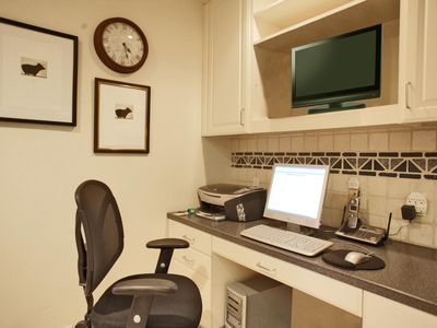 Office area in kitchen with broadband access computer, wireless and fax