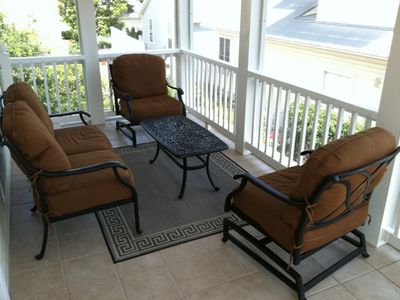 Relax on the newly tiled screened porch off the master bedroom.