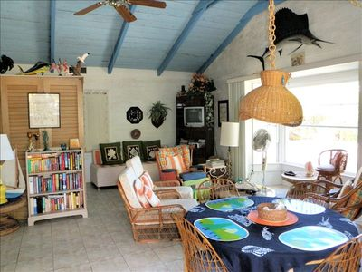 Andros cottage rental - Cottage - living/dining & kitchen area. Bay window view to beach & dock