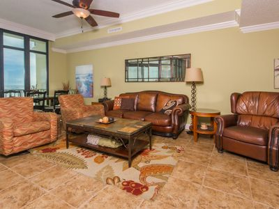 Seating area in family room,  2 swivel rockers, leather recliner & leather couch