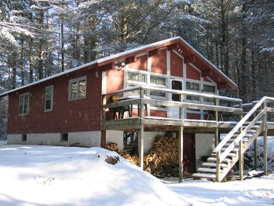 The Roger's Chalet all dressed in white - The Franconia Notch region of New Hampshire's White Mountaisn gets plenty of winter's snow to make skiing a great past time here. In fact the location of America's first ski school is just a few miles away from the chalet.