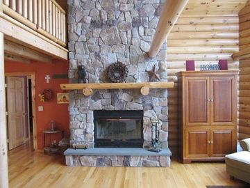 Floor to ceiling fireplace in the living room