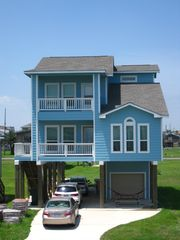 Galveston house photo - front view with parking for 4 vehicles