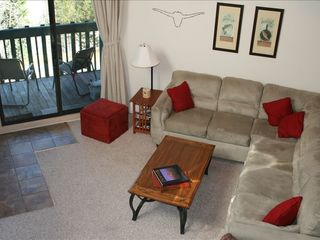 Silverthorne condo photo - living room with slidng door to balcony.