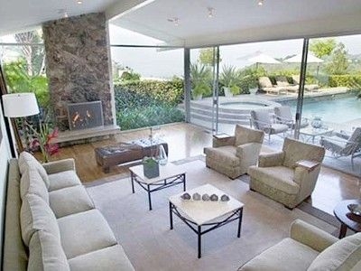 Formal living room, 10 walls of glass overlooking pool and view