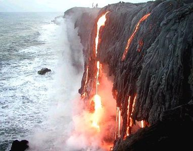 Lava flowing into ocean at Kalapana. See a couple of hikers at the top too.