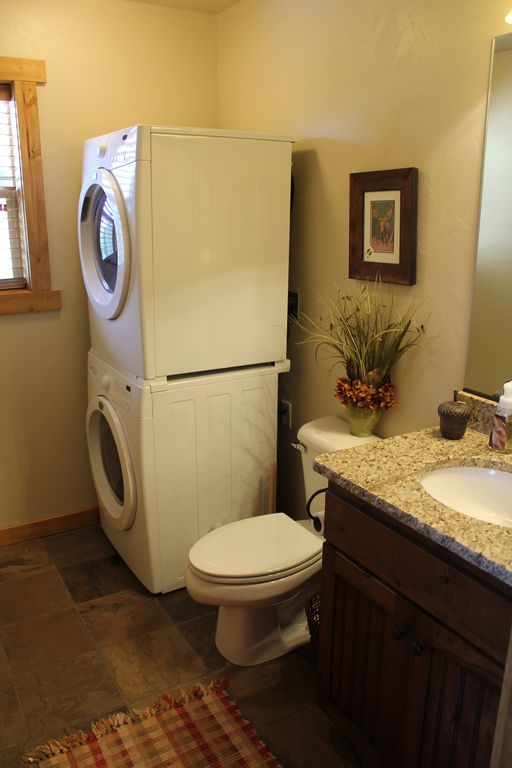 Half bath on main floor is equipped with an over/under full-size washer/dryer