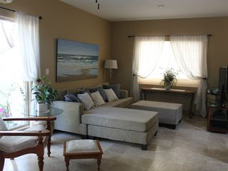 Cabo San Lucas house photo - Living area with sofa that can sleep an extra 2, satellite TV, original artwork