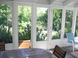 Bridgehampton house photo - Screen Porch w/expanding dining table to seat 8.