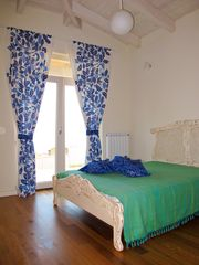 Sozopol house photo - Here is the third bedroom with a beautiful sea view and nice blue bathroom.
