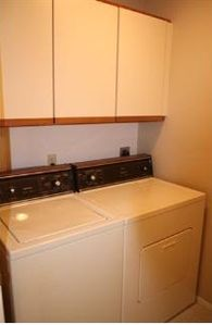Laundry room with washer / dryer in unit.