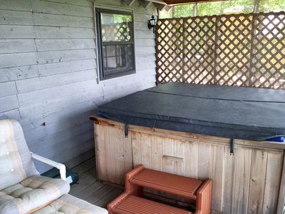 Covered deck with hot tub overlooking brow