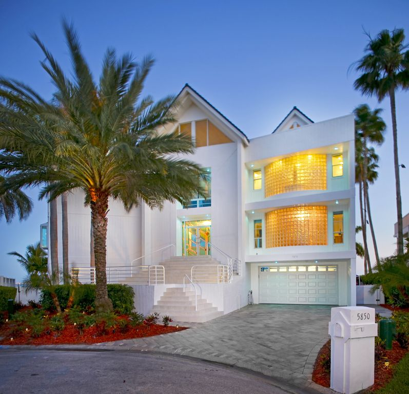 Contemporary waterfront custom built homeaway st for Modern house rental