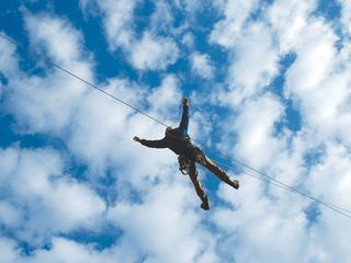 Branson cabin photo - Ziplining the sky or forest canopy is the newest craze! Photo courtesy BCC.