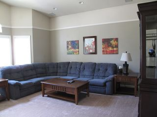 Spacious family room houses a section sofa with a pull-out sofa bed - Montgomery Estates house vacation rental photo