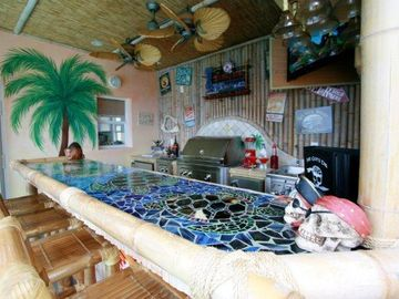 The Tiki Bar was custom designed with a beautiful mosaic sea turtle design.