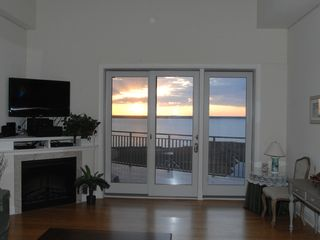 Rivendell Ocean City condo photo - Living room with bay view and sunset!