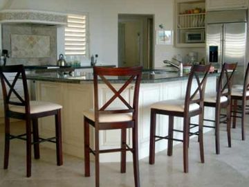 The spacious gourmet kitchen, with stainless appliances and a wine refrigerator