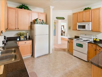 Oversized fully equipped kitchen with lots of counter space