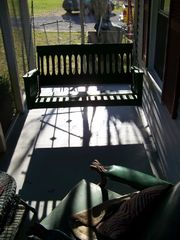 Lost River farmhouse photo - Cozy porch swing on front screened porch - relax!