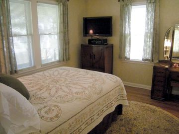 The restful bedroom has a comfy antique Double bed and a modern Flatscreen TV
