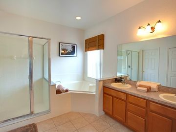 Beautiful Bathroom with double vanity, corner bath and shower.