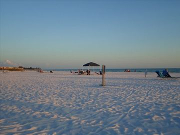 White sand beach of Siesta Key at dusk.
