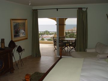 Second master suite w/ king bed, private bathroom, opens to terrace, ocean view