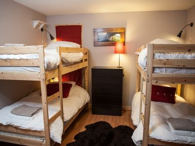 Upstairs Bunk room, 2 bunk beds, 2 dressers, reading lamps for each bed, closet