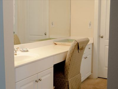 Large separate dressing room with her vanity and spacious closet.